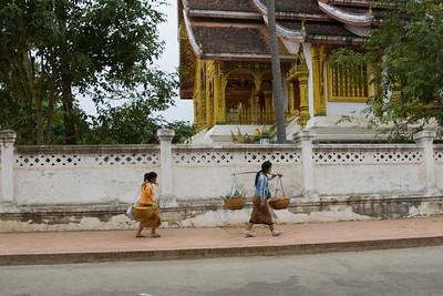 Women peddling goods outside the temple in Luang Prabang, Laos