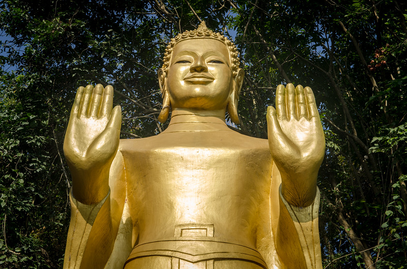 Standing buddha on Mount Phousi.