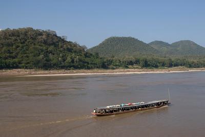 Boat cruising the Mekong River in Luang Prabang, Laos