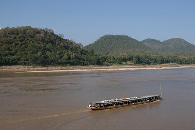 Boat cruising the Mekong River in Luang Prabang, Laos