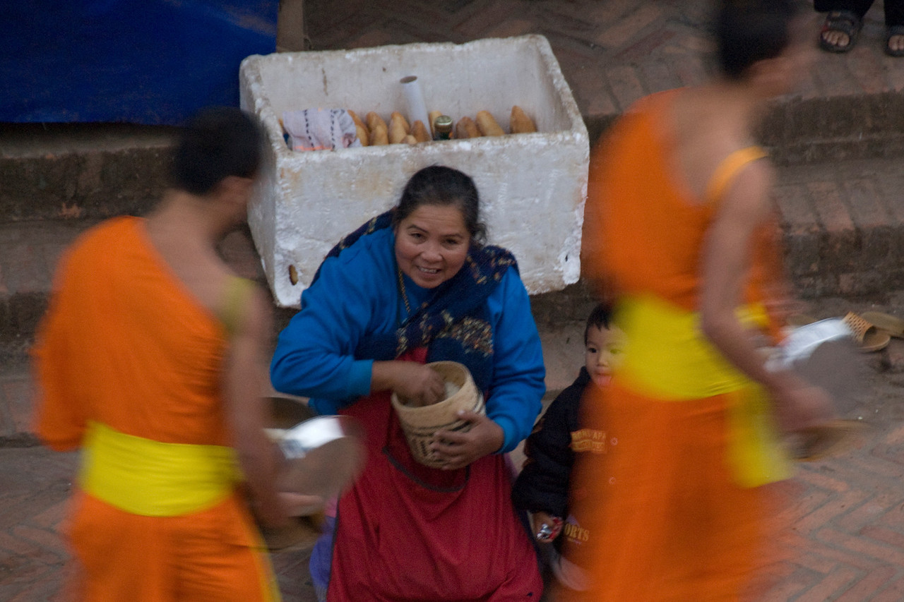 Close-up of woman on alms giving ceremony in Luang Prabang, Laos
