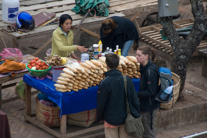 Tourists buying from sandwich vendor at Luang Prabang, Laos