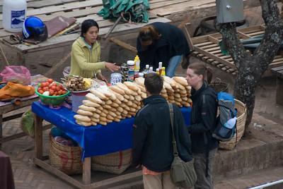 Tourists buying from sandwich vendor at Luang Prabang, Laos