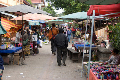 Stall vendors at day market in Luang Prabang, Laos