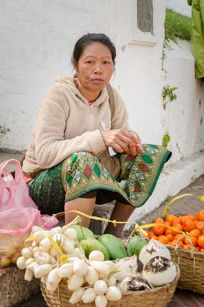 Woman selling fruit and veggies on Sisavangvong Road.