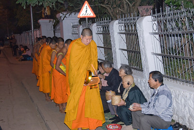 Locals joining in on alms giving ceremony at Luang Prabang, Laos