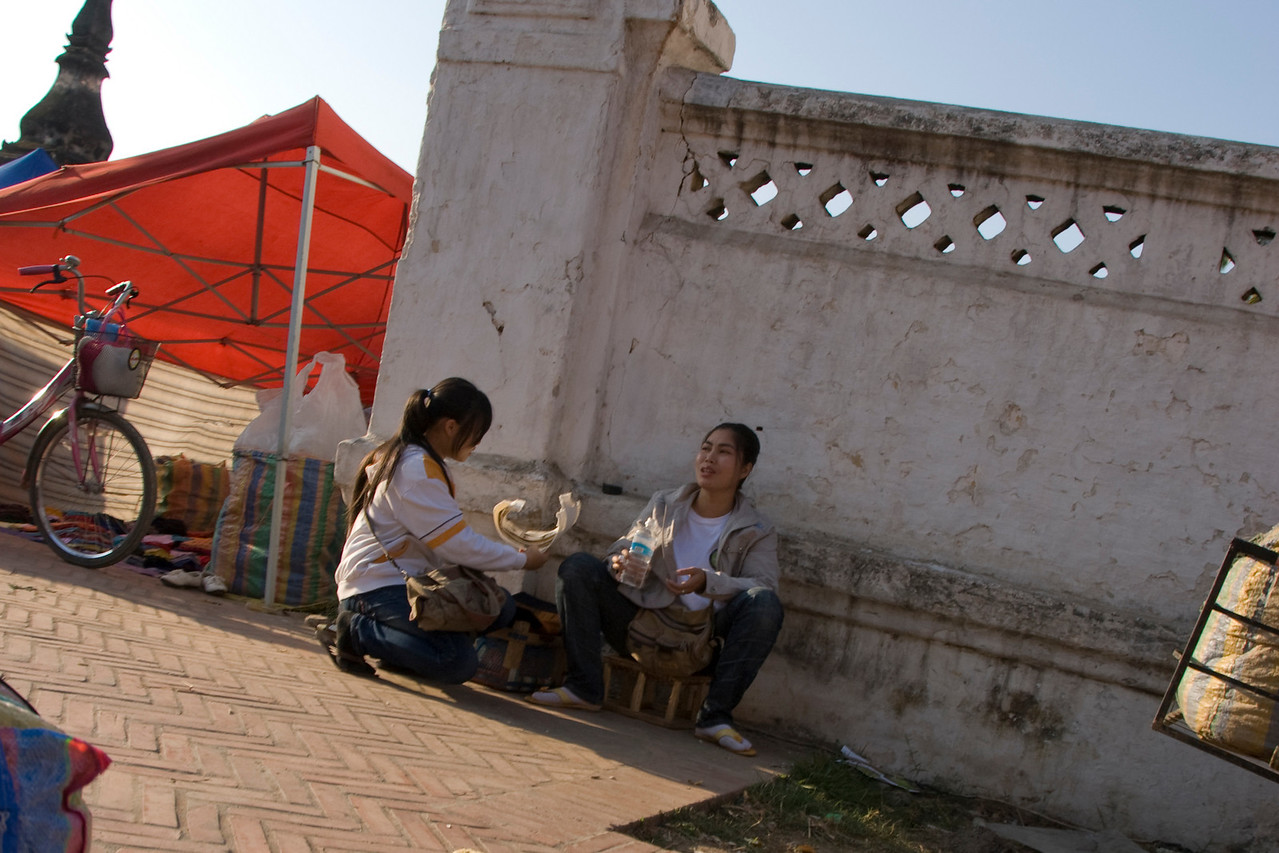 Women resting on a side street in Luang Prang, Laos