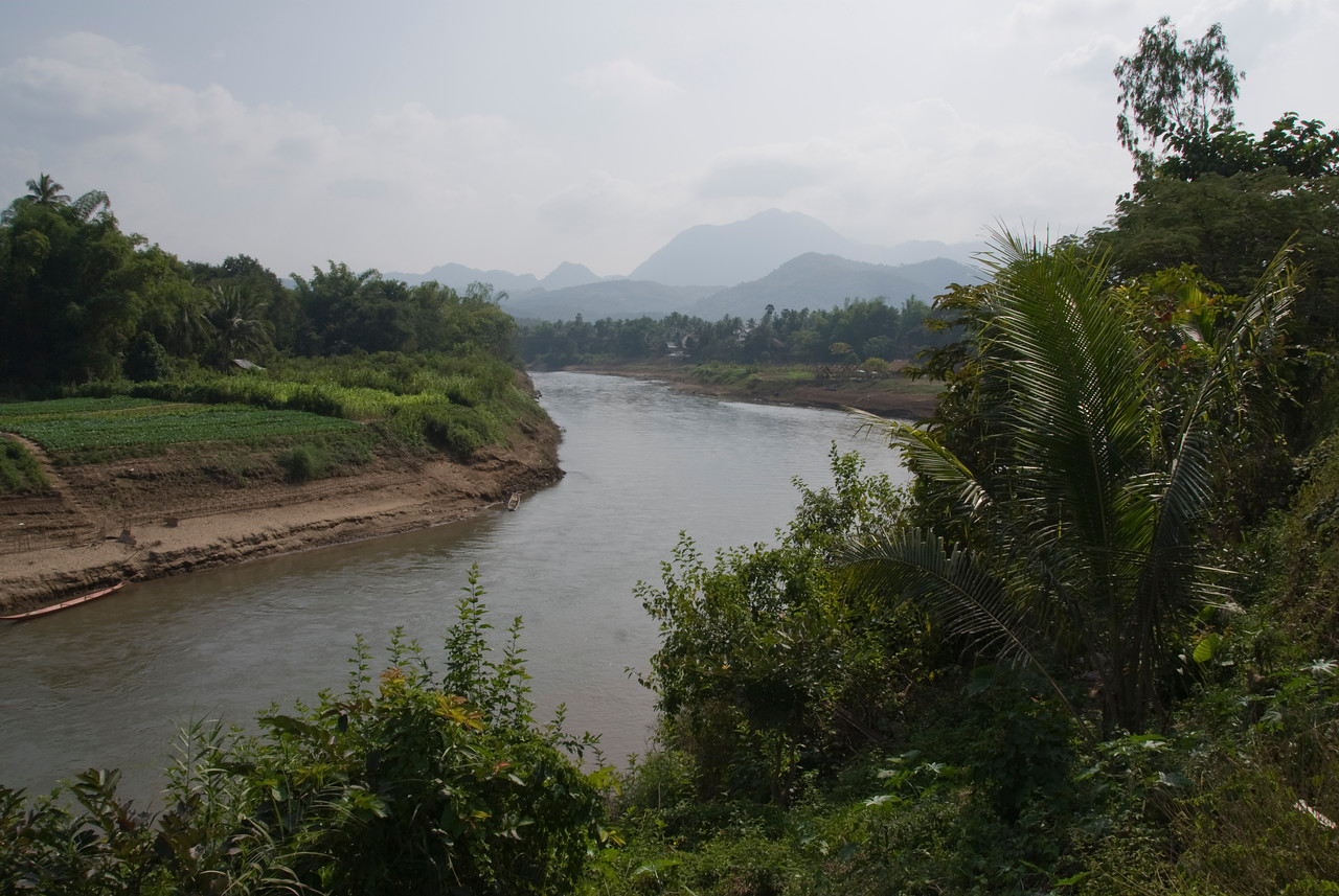 Shot of the Mekong River and rice fields nearby -Luang Prang, Laos