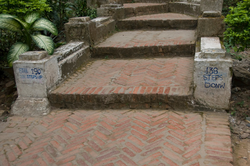Writings on the end of stairs at a temple in Luang Prang, Laos