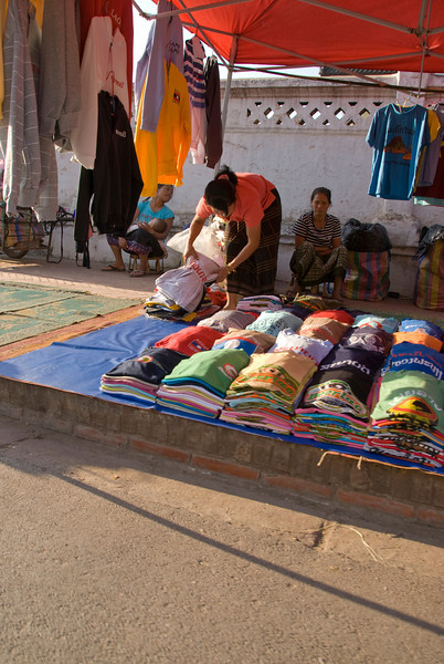 Vendor selling clothes at a day market in Luang Prang, Laos