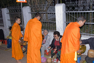 Alms giving during ceremony at Luang Prabang in Laos