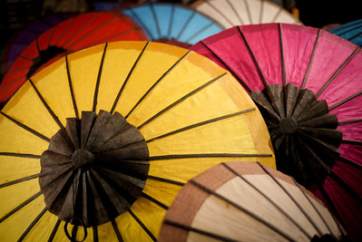 Pretty close up of paper umbrellas in Luang Prabang's nightly street market, Laos.