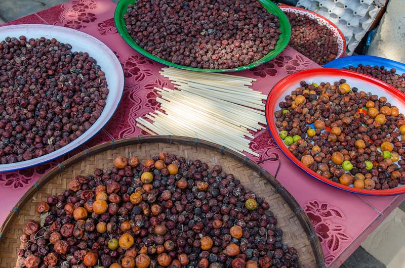 Fruit drying in pans.