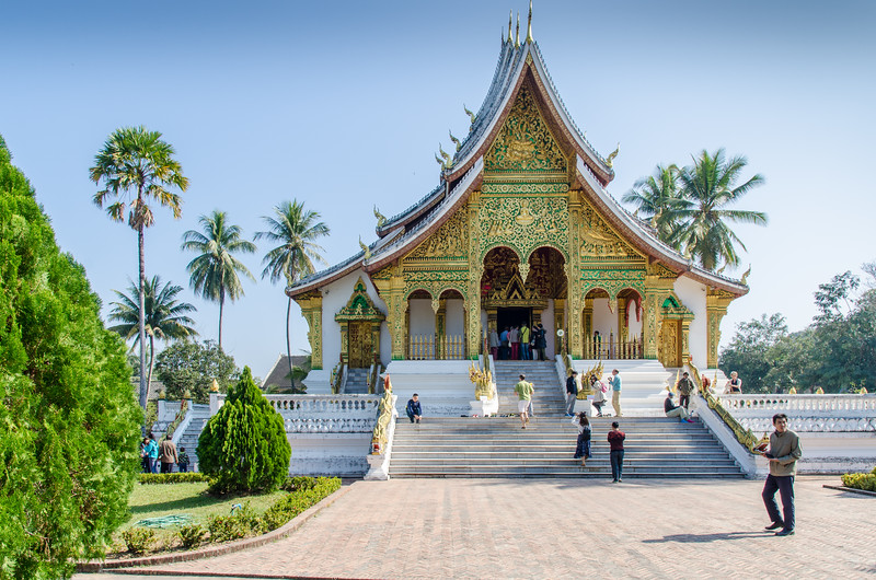 "On the grounds of the Royal Palace Museum is the Haw Pha Bang, one of Luang Prabang's most attractive monuments. A very ornate temple, the Haw Pha Bang which translates to ""Royal temple"" is also known as the Wat Ho Pha Bang. It was built to house Laos' most sacred Buddha image."