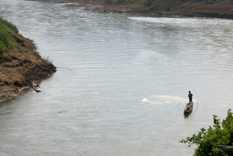 Man fishing at the Mekong River in Luang Prang, Laos