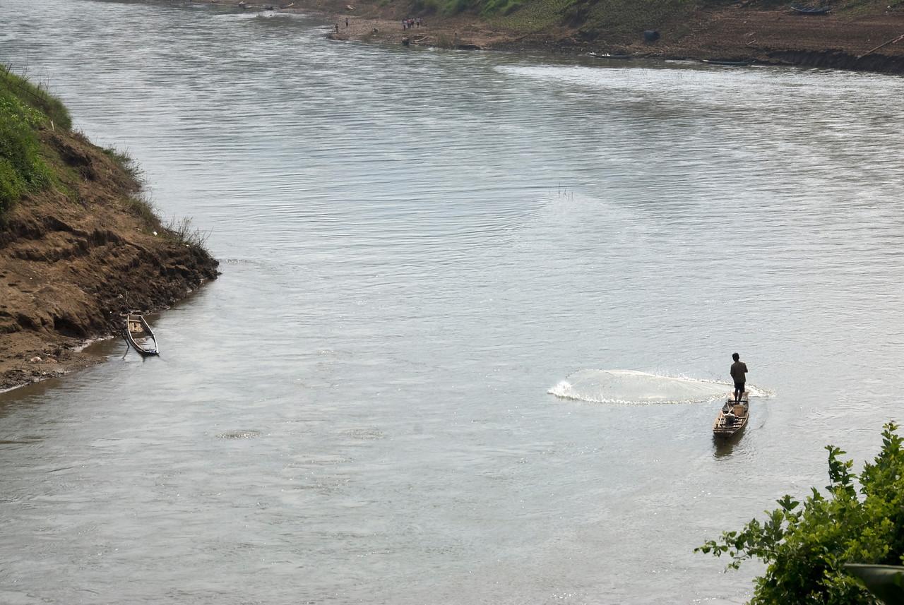 Man fishing at the Mekong River in Luang Prang, Laos