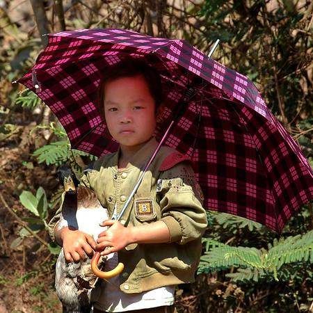Girl with a Duck - Luang Prabang, Laos