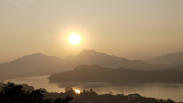 The sun takes a leisurely time setting in Luang Prabang, Laos