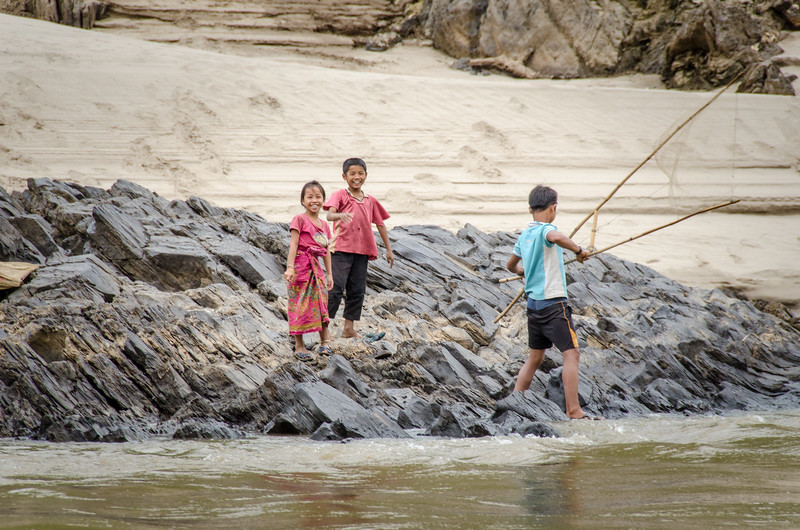 Happy kids on the bank of the Mekong.