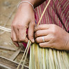 Lady making a thatched roof.