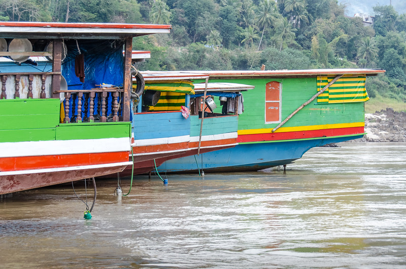 Slow boats tied up on the riverbank in Pak Beng,