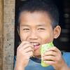 Boy enjoying a snack.