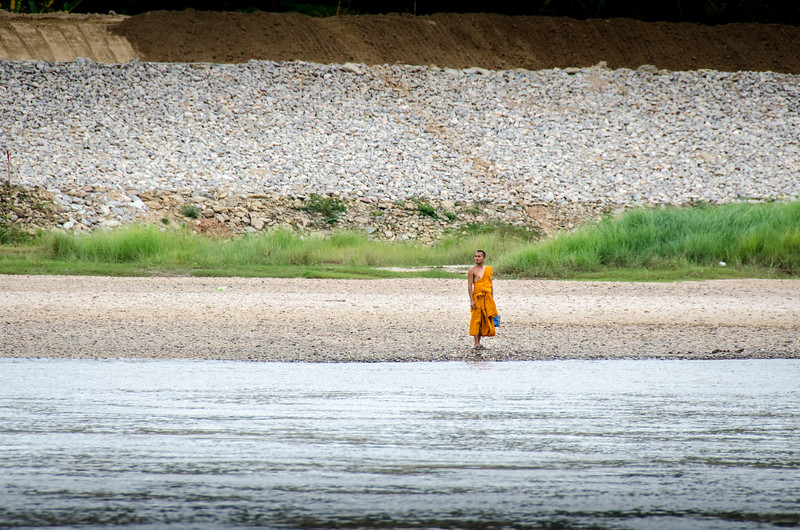 Lone monk on the shore of the Mekong.