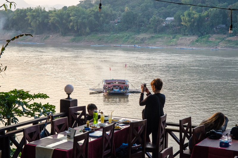 A ferry approaches Luang Prabang at sunset.