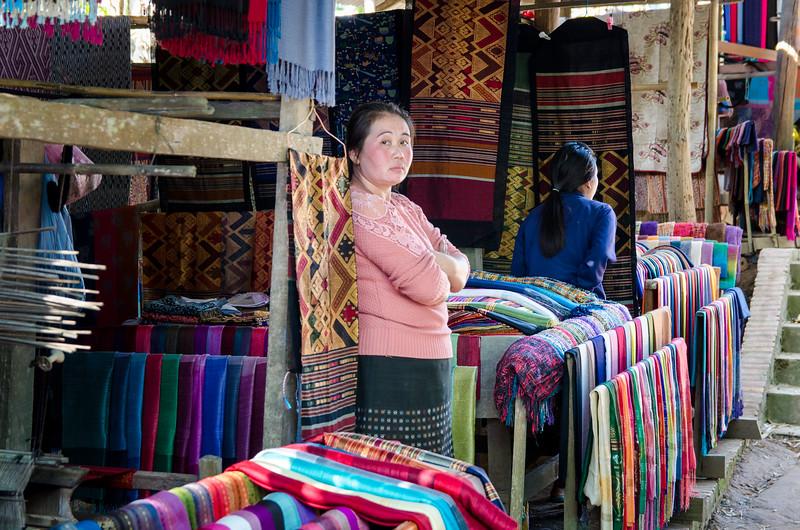 A woman selling silk.