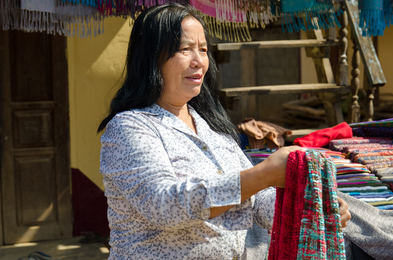 A woman selling silk scarves.