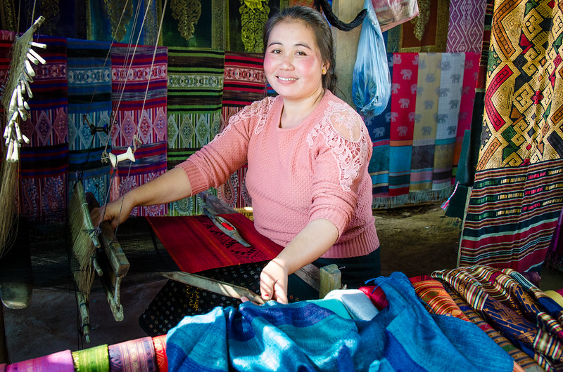 A woman weaving silk.