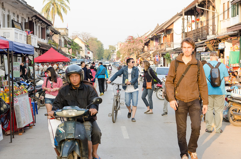 Strolling the main street in Luang Prabang.
