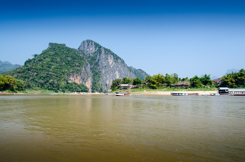 The confluence of the Mekong and the Nam Ou rivers. Pak Ou village in the foreground.