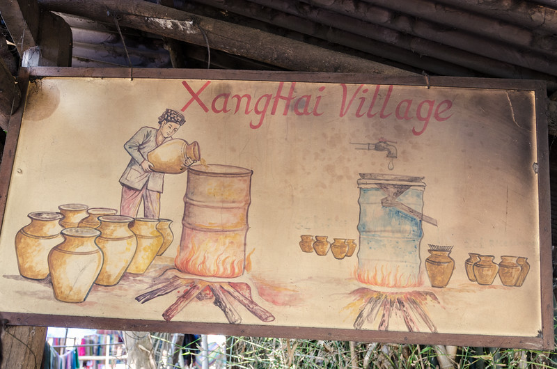 A sign welcoming visitors to XangHai Village.
