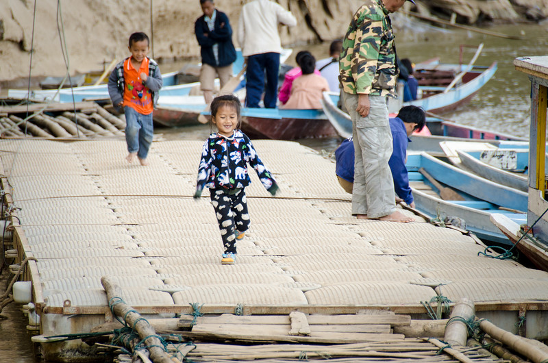 Children play on the dock at the Pak Ou caves.