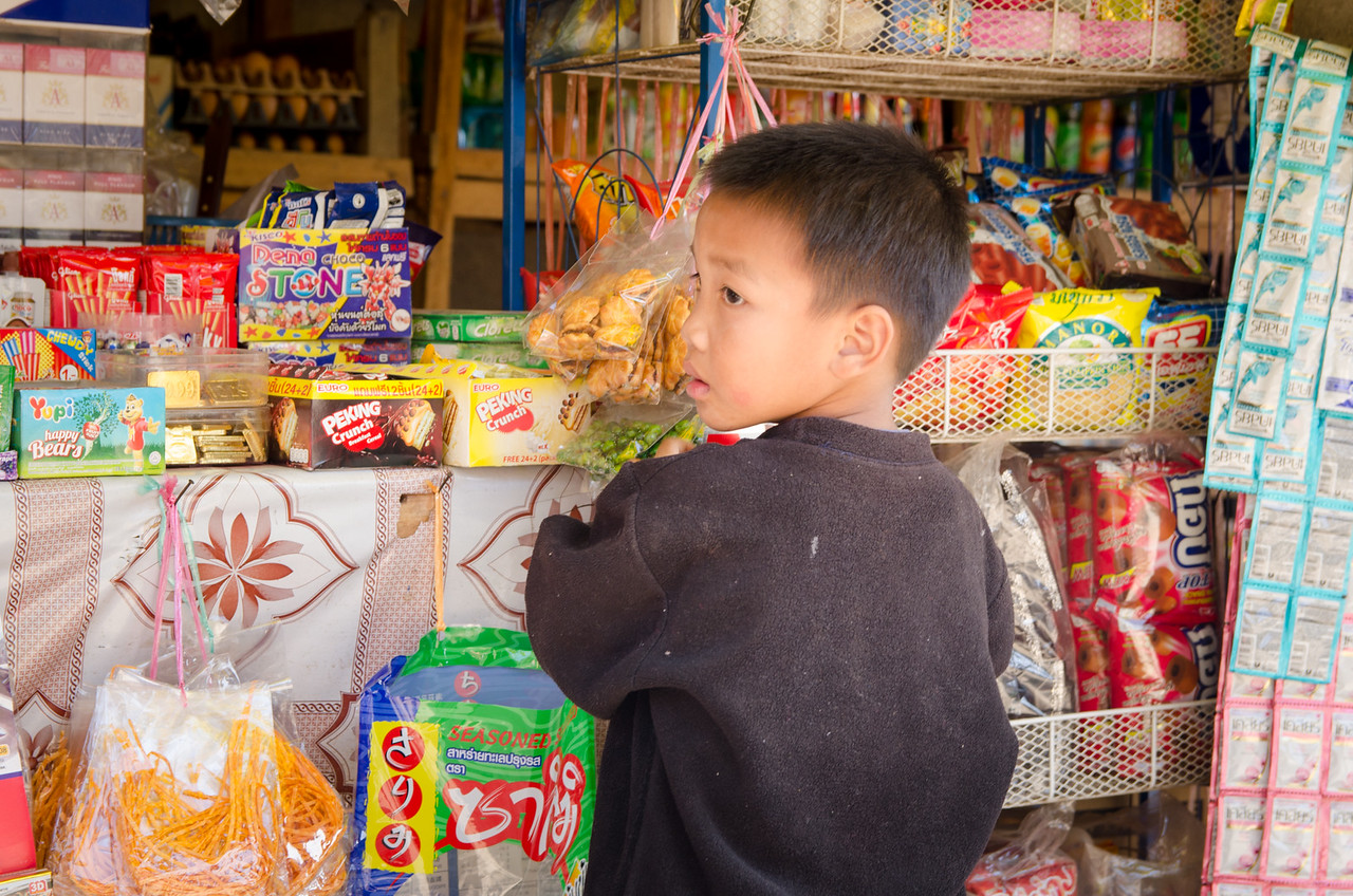 A boy at a shop in the village.