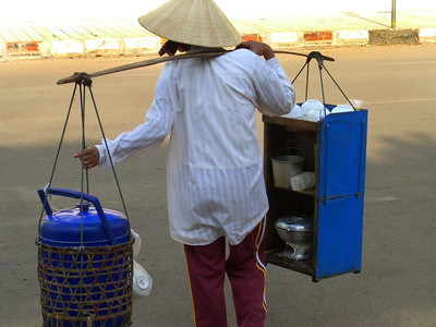 Woman Carrying Her Mobile Restaurant - Vientiane, Laos