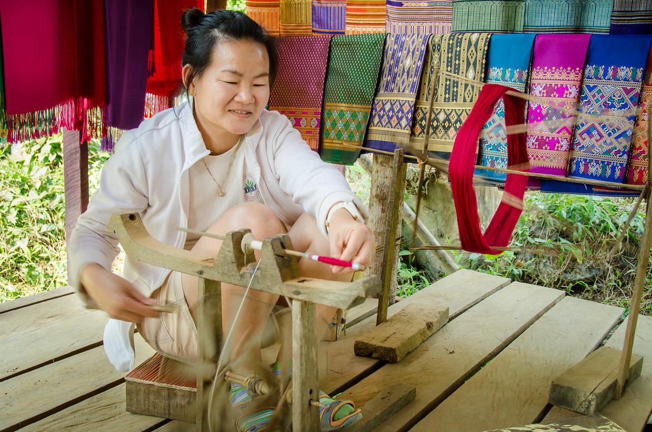 Lao woman making silk thread.