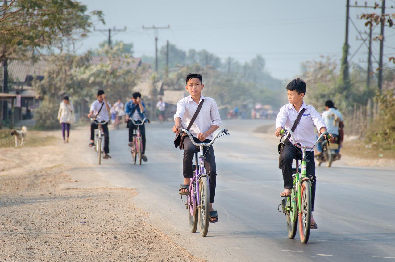 School children biking home.