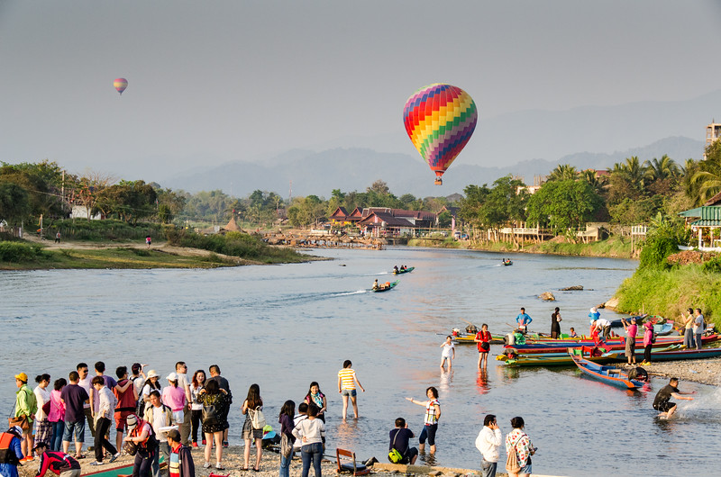 A hot air balloon rises over the Nam Song River.