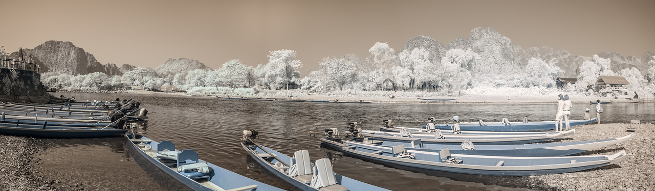 An infrared panoram of tradtional Lao boats on the Nam Song river.