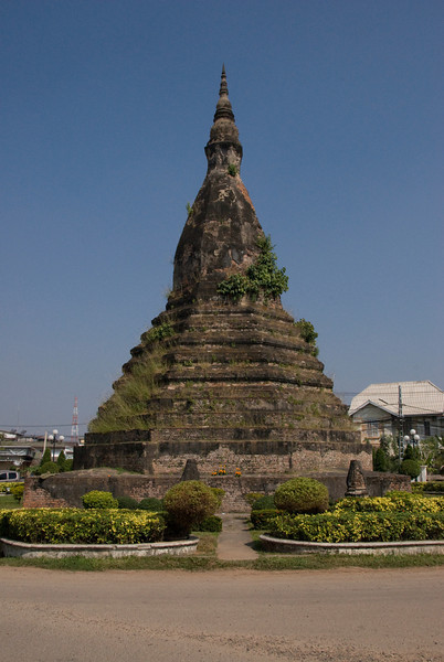 A closer shot of the roundabout shrine in a street in Vientiane, Laos