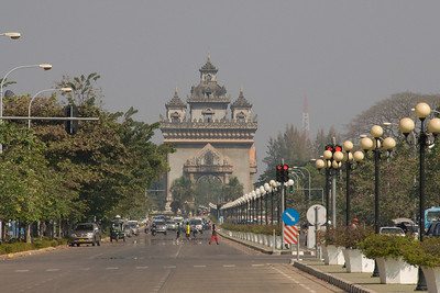 Shot of the busy traffic with Patousai Arch in the background - Vientiane, Laos