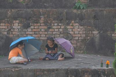 Girls Playing at Shrine in Vientiane, Laos