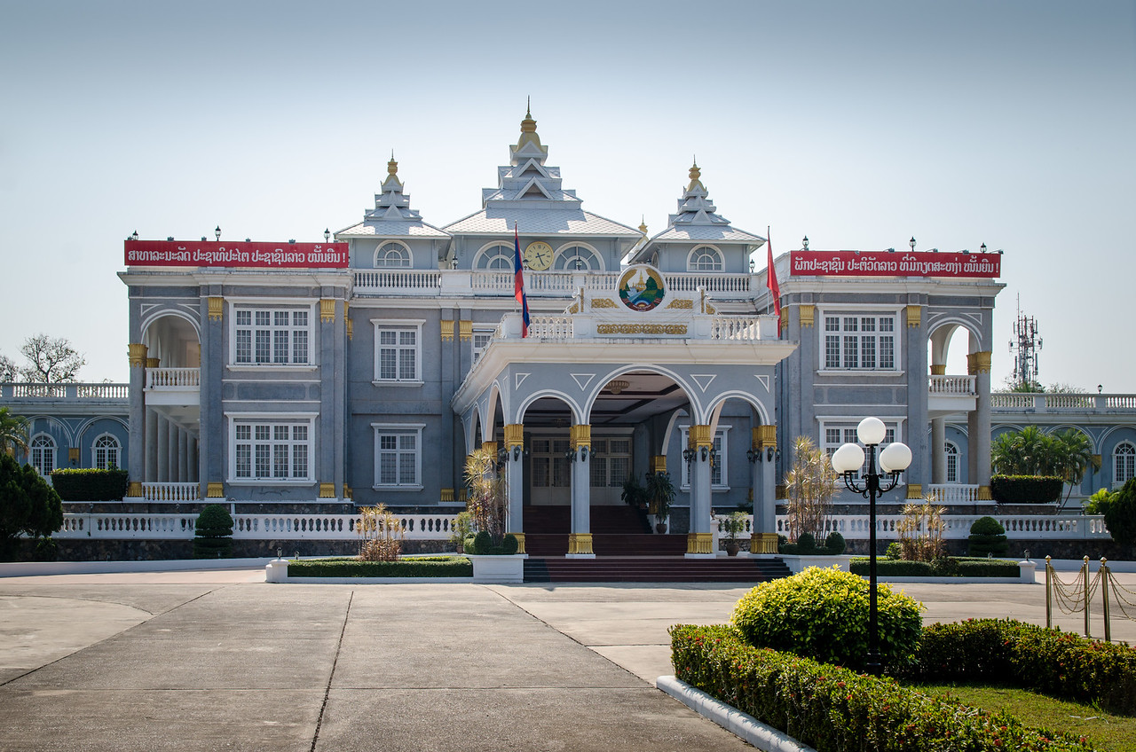 The Presidential Palace is the official residence of the President of Laos, who, informally, also holds the position of General Secretary of the Lao People's Revolutionary Party. It is located on the banks of the Mekong River in the capital city, Vientiane.<br /> Located near Sisaket Temple in the junction of Lane Xang Avenue and Settathirath Road, the building was first started in 1973 by the then Royal Lao Government on the grounds that used to house the royal residence. It was designed by local architect Khamphoung Phonekeo but due to political change brought about by the takeover of the communist Pathet Lao in 1975, the building was not completed until much later. The Presidential Palace finally opened its doors in 1986 and even then only as a venue for government functions and ceremonies. The building is closed to the public. It is a well-known landmark for its imposing yet elegant Beaux-Arts architecture complete with tall colonnades and shaded balconies. The building is surrounded by well-manicured lawns and gardens and fenced off by tall walls and a wrought iron gate. The Presidential Palace is not to be confused with the official home of the Lao president which is located in the Vientiane suburb of Ban Phonthan.