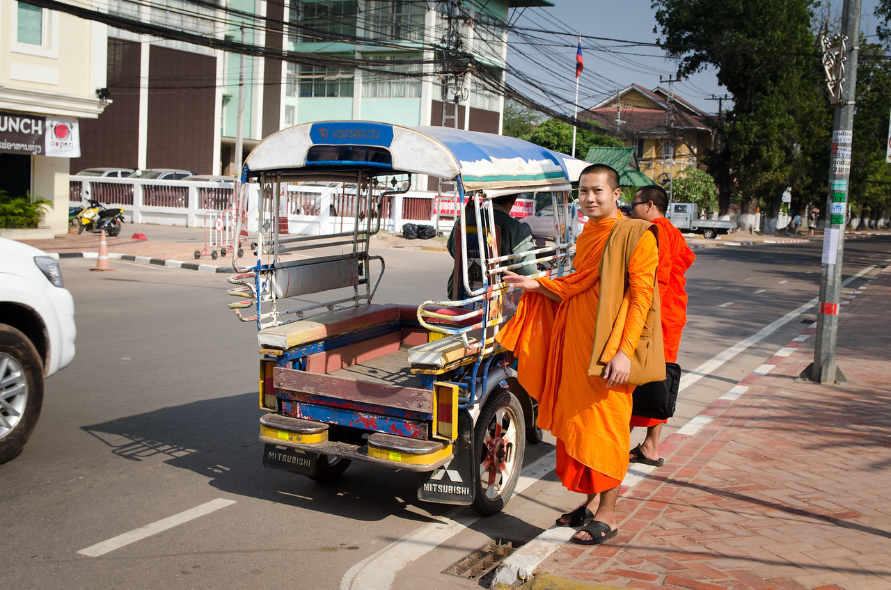 Monks about to get in a tuk-tuk.
