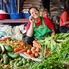 A woman selling vegetables in the Thong Khan Kham Market.