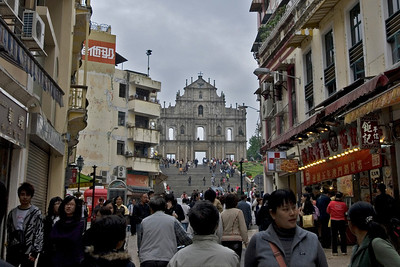 Tourists filling up the streets near St. Paul's facade i Macau