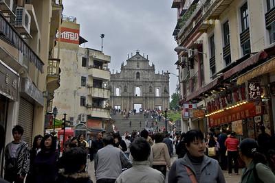 Tourists filling up the streets near St. Paul's facade i Macau