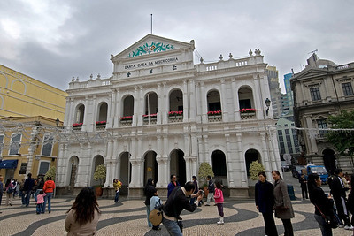 Tourists posing in front of Santa Casa de Misericordia in Macau